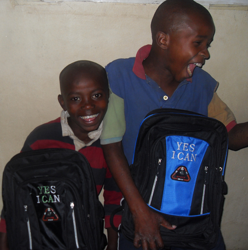 Yves and Kasungu are happy with their new bags